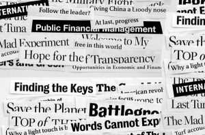 Various snippets of newspaper headlines spread out across a white background.
